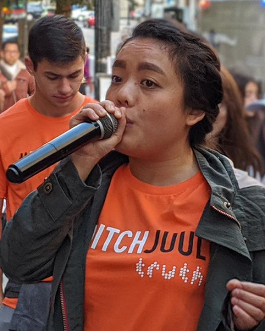 girl with microphone at rally